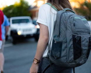 Paediatric Rheumatology Network is supported by The Sydney Children's Hospital Network. Photo by Omar Roque on Unsplash, pictures a young woman carrying a grey backpack